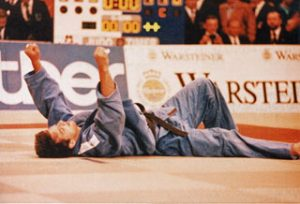 Pawel Nastula relaxing during a break in fighting at 1996 Olympic Games