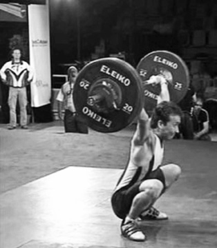 Side view of an Olympic weightlifting snatch performed by Tom Goegebuer, Belgium.